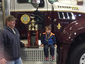 Firefighter Errickson with grandson Andrew Martin