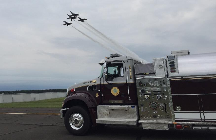 Members standby at Millville air show.